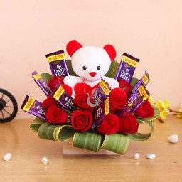 Gift Combo of 10 Cadbury Dairy Milk + 10 Red Roses + 1 Teddy(6 inch) In a Box Arrangement