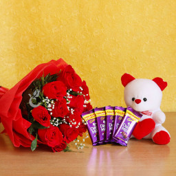 Gift Hamper of 10 red roses bouquet with Cadbury dairy milk and  teddy